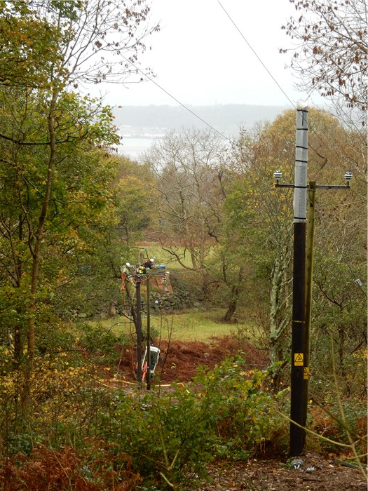 Scottish Power contractors working to upgrade the powerlines above the village 16 November 2015