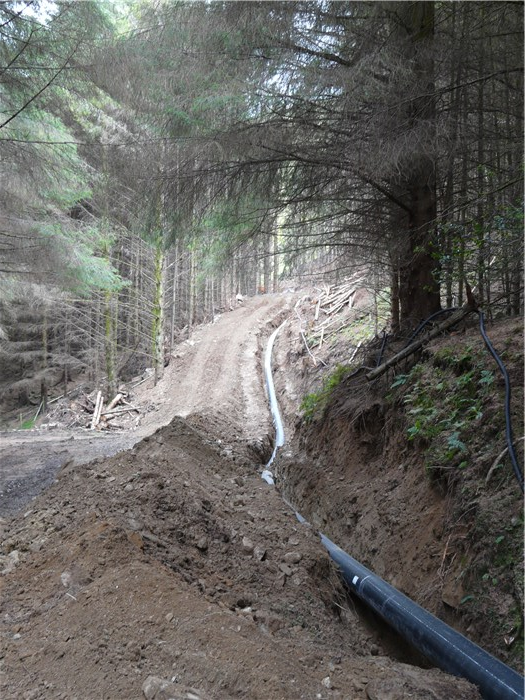 Pipeline reaches the forest track where it will be buried in the uphill bank 15 July 2015