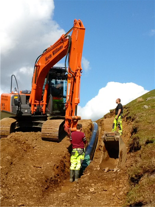 The pipe is drawn into the trench 3 June 2015