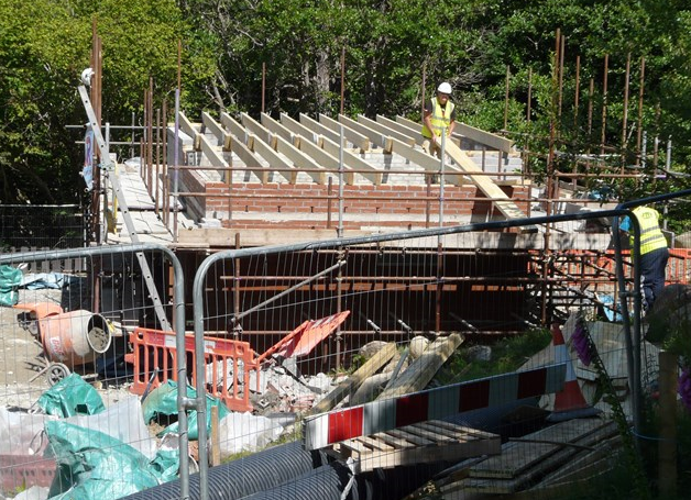 The rafters supporting the sedum turf roof are installed 15 July 2015