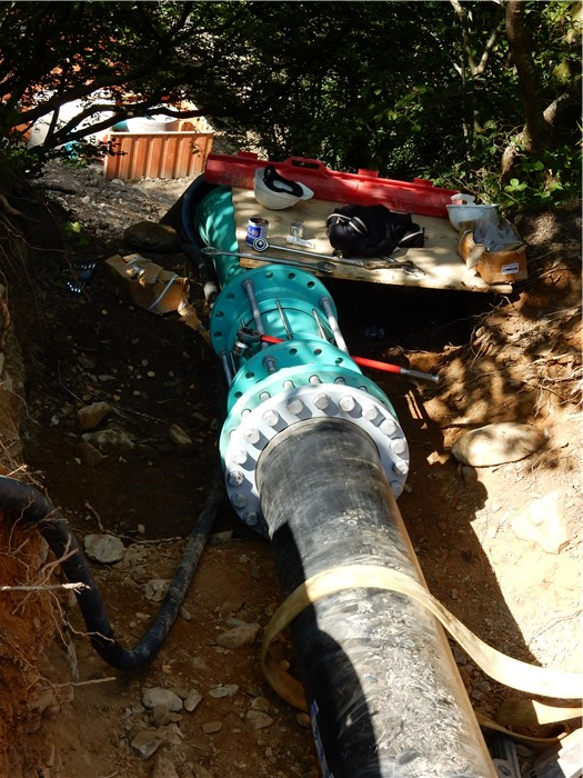 The polyethylene pipe under the forest road is connected to the steel pipe at the top of the bank 8 Sept 2015