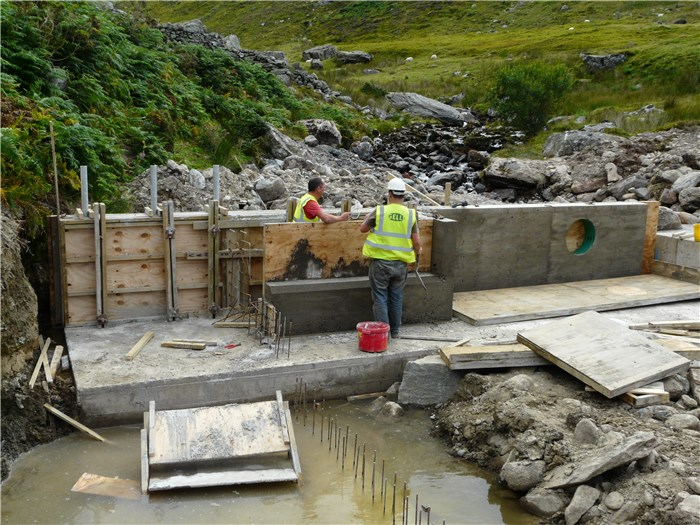 The shuttering is removed to reveal the weir structure 13 Aug 2015