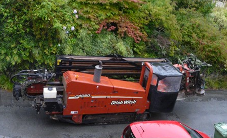 Scottish Powers drilling rig the Ditch Witch is tracked up through the village 2 Sept 2015