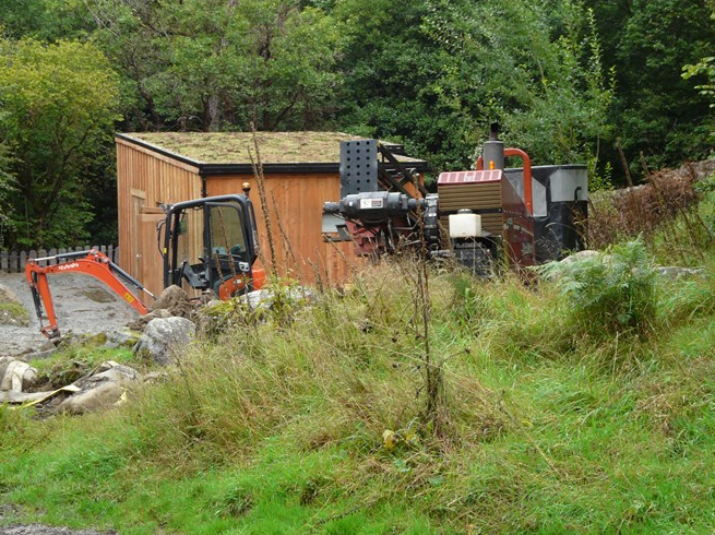 The Ditch Witch is positioned behind the turbine house 2 Sept 2015